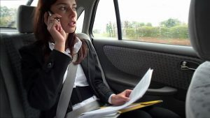 woman-talking-on-cell-phone-in-car