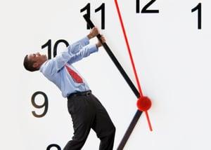 man-yanking-clock-hand-back