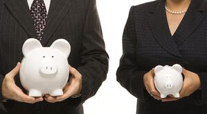 two-business-people-holding-piggy-banks