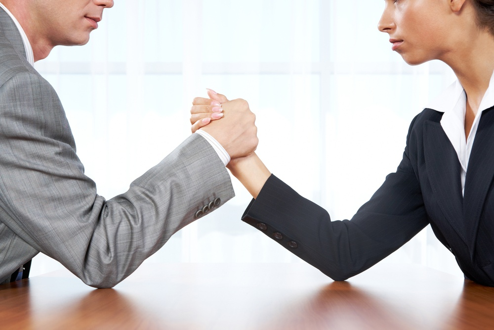 business man woman compete competition arm wrestle.jpg