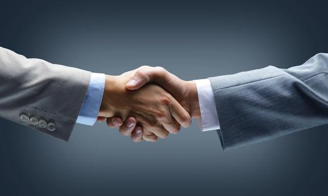 two businessmen shake hands