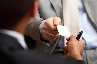 man hands business card.jpg