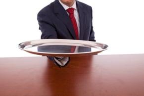 man-holding-silver-platter.jpg