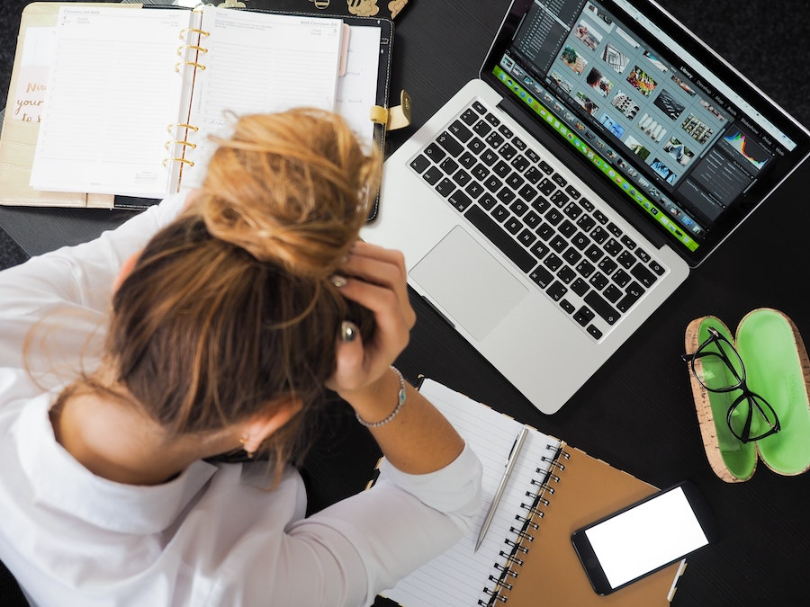 woman-using-laptop-stressed-overwhelmed
